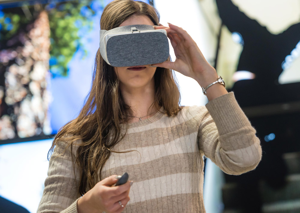 student uses augmented reality goggles.