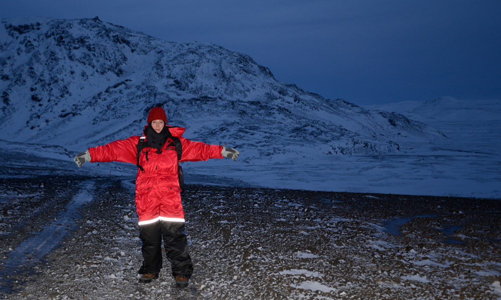 Erica Massey standing in front of Helgafell, a glaciovolcanic ridge in Iceland