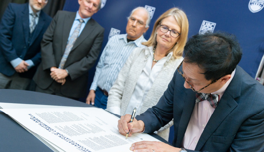 Santa Ono signing UBCO's TRC declaration