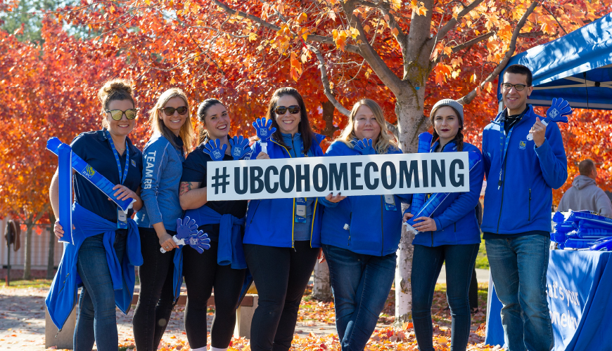 A group of people celebrating Homecoming