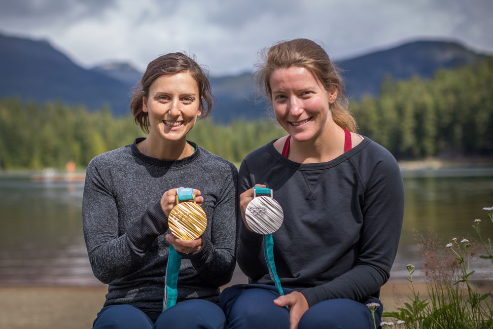 Kelsey Serwa and Brittany Phelan pose with their Olympics medals.