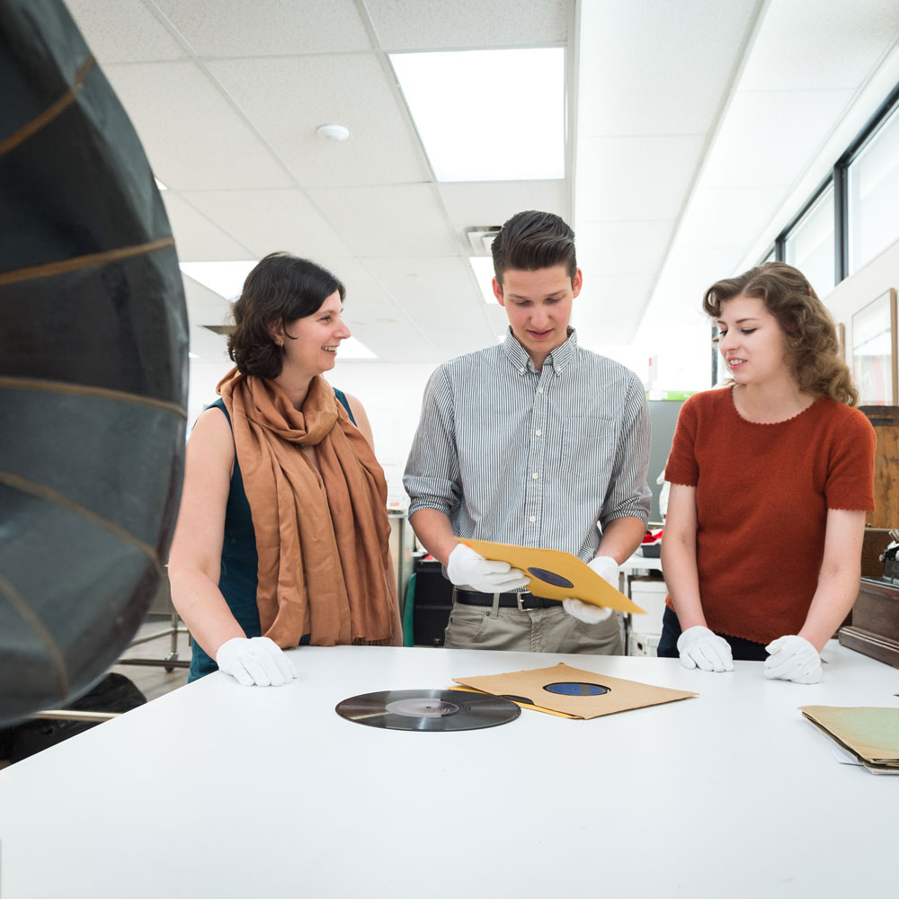 Prof. Brigitte LeNormand examining records with students.