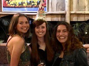 Willa Holmwood (centre) celebrating her birthday in Tanzania with roommates Adanna Farrow (left) and Arielle Shakour.