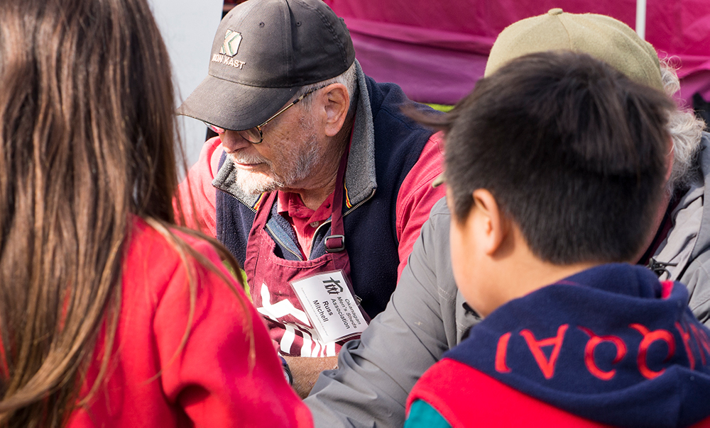 A member of the mobile Men's Shed working with children