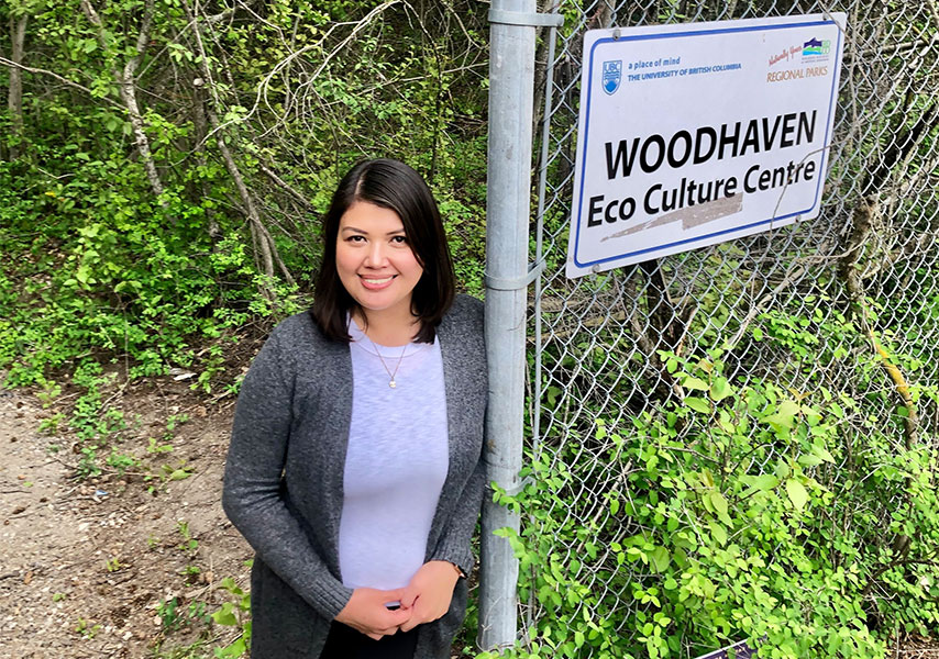 Rina Garcia Chua in front of Woodhaven sign