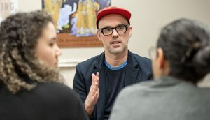 Associate Professor Michael V Smith engages in small group discussion with students.