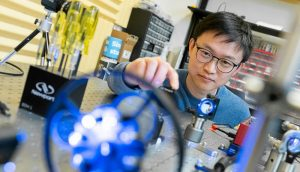 A UBCO chemistry professor works in a lab.