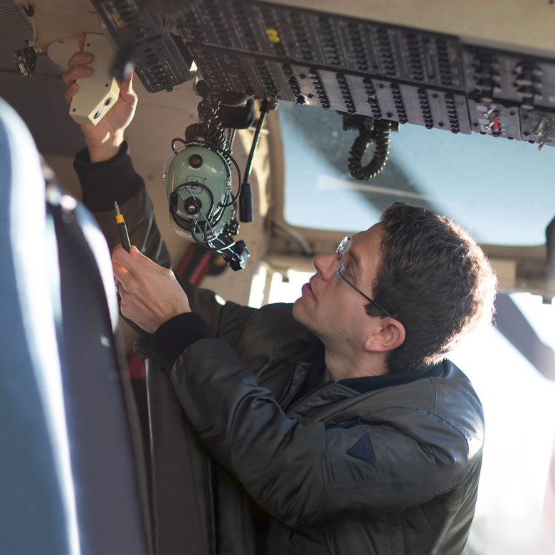 UBCO entrepreneur in the cockpit of a helicopter
