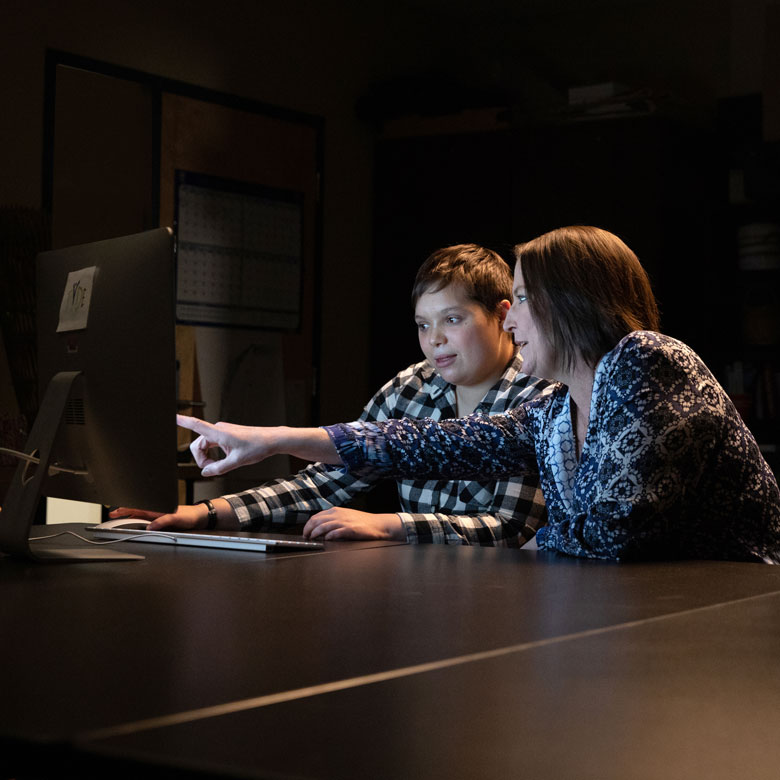 Two women working together at a computer