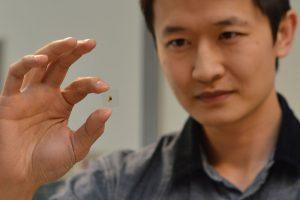 Ken Chau with a piece of smart glass