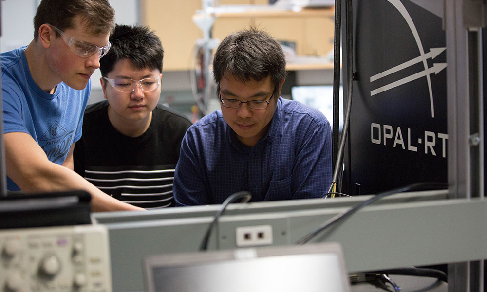 Professor Liwei Wang in his lab with students