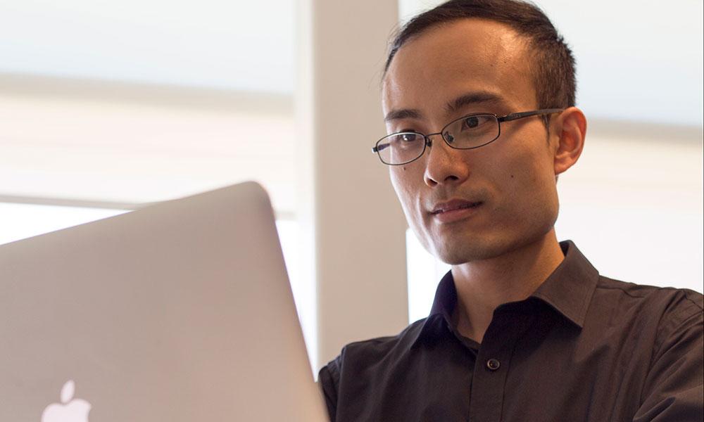 Chen Feng at computer