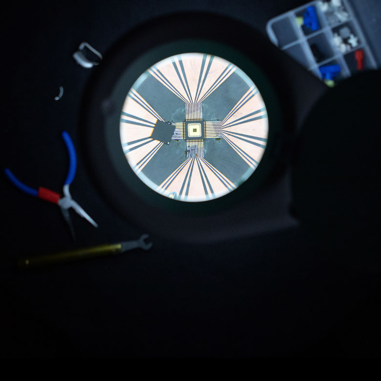 microchip under a huge magnifying glass