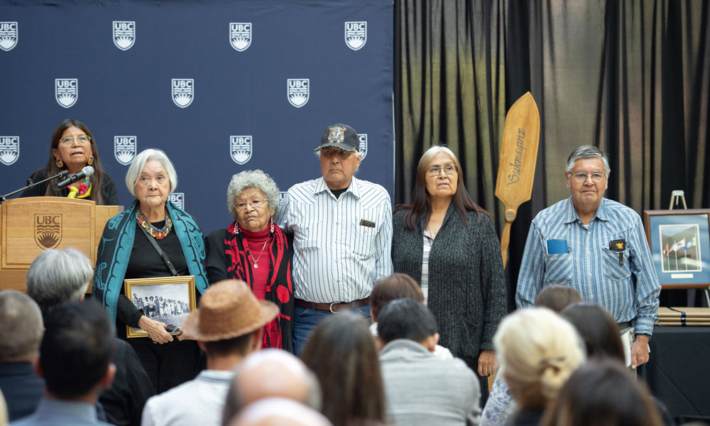 Eric Mitchell stands with fellow residential school survivors.